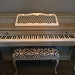 upright piano with matching bench